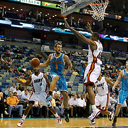 October 13, 2010; New Orleans, LA, USA; New Orleans Hornets shooting guard Marco Belinelli (8) passes the ball past Miami Heat center Dexter Pittman (45) during the second half of a preseason game at the New Orleans Arena. The Hornets defeated the Heat 90-76. Mandatory Credit: Derick E. Hingle