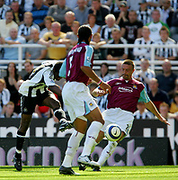 Photo: Andrew Unwin, Digitalsport<br /> Newcastle United v West Ham United. The Barclays Premiership. 20/08/2005.<br /> Newcastle's Charles N'Zogbia (L) takes a shot at goal.<br /> Norway only