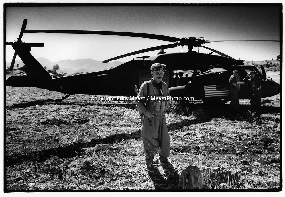 BARZAN, KURDISTAN, IRAQ, OCTOBER 1993. A Kurdish fighter guards an American Blackhawk helicopter. The choppers are frequently used by the allied forces Military Control Center, an intelligence organisation. ©Photo by Frits Meyst/NewsImages