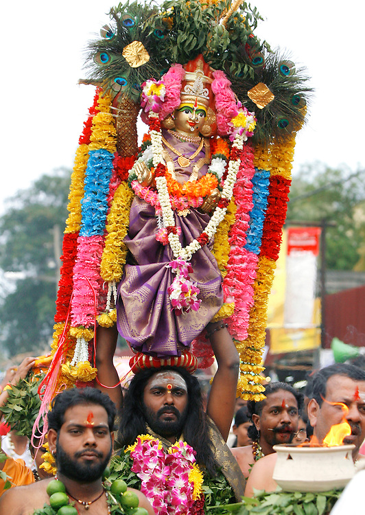 """Hindu devotee walks to the sacred Batu Caves temple during the Thaipusam festival in Kuala Lumpur, Malaysia. Hindu devotees celebrate Thaipusam festival in honour of the Lord Murugan (also known as Lord Subramaniam). Thousands of Hindu devotees carried the milk pots and """"kavadi"""" (a gaily decorated wooden or metal frame) walk barefoot up the temple's 272 steps to undergo penance in fulfilling vows made to Lord Murugan for answering their prayers."""