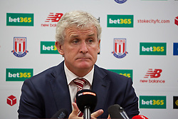 STOKE-ON-TRENT, ENGLAND - Sunday, August 9, 2015: Stoke City manager Mark Hughes during a post-match press conference after the 1-0 defeat by Liverpool during the Premier League match at the Britannia Stadium. (Pic by David Rawcliffe/Propaganda)