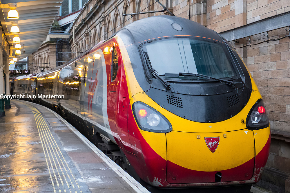 Virgin Trains Pendolino locomotive to London Euston  on West Coast Main line  at platform at Waverley Station in Edinburgh, Scotland, United Kingdom
