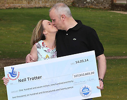 Neil Trotter a  car mechanic and racing driver from Coulsdon, United Kingdom kisses his partner Nicky Ottaway at a hotel in Dorking, United Kingdom, after winning the £108 million (pounds sterling) EuroMilllions lottery, Tuesday, 18th March 2014. Picture by Stephen Lock / i-Images