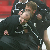 St Johnstone Training...17.10.03<br />Brian McLaughlin enjoying a scrap during training this monring.<br />See story by Gordon Bannerman Tel: 01738 553978<br />Picture by Graeme Hart.<br />Copyright Perthshire Picture Agency<br />Tel: 01738 623350  Mobile: 07990 594431
