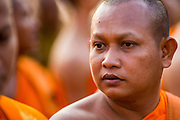 "01 FEBRUARY 2013 - PHNOM PENH, CAMBODIA:   A Buddhist monk at the funeral procession of former King Norodom Sihanouk. Norodom Sihanouk (31 October 1922 - 15 October 2012) was the King of Cambodia from 1941 to 1955 and again from 1993 to 2004. He was the effective ruler of Cambodia from 1953 to 1970. After his second abdication in 2004, he was given the honorific of ""The King-Father of Cambodia."" Sihanouk died in Beijing, China, where he was receiving medical care, on Oct. 15, 2012. His cremation is will be on Feb. 4, 2013. Over a million people are expected to attend the service.  PHOTO BY JACK KURTZ"