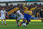 Joss Labadie (4) is challenged by Krystian Pearce (5) during the EFL Sky Bet League 2 second leg Play Off match between Mansfield Town and Newport County at the One Call Stadium, Mansfield, England on 12 May 2019.
