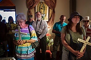 17 APRIL 2005 - NACO, AZ: Progressive Christians on the US side of the US/Mexico border at an interfaith prayer  service in Naco, AZ. The Christians had gathered to protest the presence of the  Minuteman Project in Naco. The Minuteman volunteers were hunting migrants who crossed the border outside of Naco.      PHOTO BY JACK KURTZ