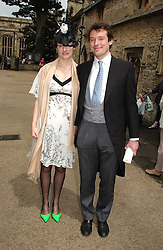 HENRY & POPPY HUGHES at the wedding of Hugh van Cutsem to Rose Astor in Burford, Oxfordshire on 4th June 2005.<br />