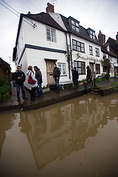 © London News Pictures. 01/05/2012. Tewkesbury, UK. Flood water which is approaching houses in Tewkesbury, Gloucestershire, England on May 1, 2012. The UK has had its wettest April in over a century, with some areas seeing three times their usual average rainfall, according to figures from the Met Office. Photo credit : Ben Cawthra /LNP