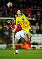 Bristol City's Liam Fontaine battles for the high ball with Crystal Palace's Chris Martin - Joe Meredith/JMP - 14/02/12 - SPORT - FOOTBALL -  Championship -  Ashton Gate - Bristol, England - Bristol City v Crystal Palace