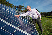 Kevin Smith, comunications director of WREN with the  100kW solar array built by WREN, working together with South West Water, to power Nanstallon Sewage Treatment Works. WREN community energy. Wadebridge, Cornwall. UK