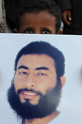 A family member of a Yemeni prisoner in Guantanamo displays a picture of him during a rally demanding the release of prisoners held in Guantanamo, in front of the Yemeni President s Palace, in Sanaa, Yemen,  January 14, 2013. Photo by Imago / i-Images...UK ONLY