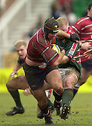 © Peter Spurrier/ Intersport Images.Photo Peter Spurrier.01/03/2003 Sport - Semi final Powergen Cup Rugby -.Leicester  v Gloucester - Franklin Gardens.Jake Boer (with ball) driving through the Leicester defence.and breaking the tackle of Dorian West. .