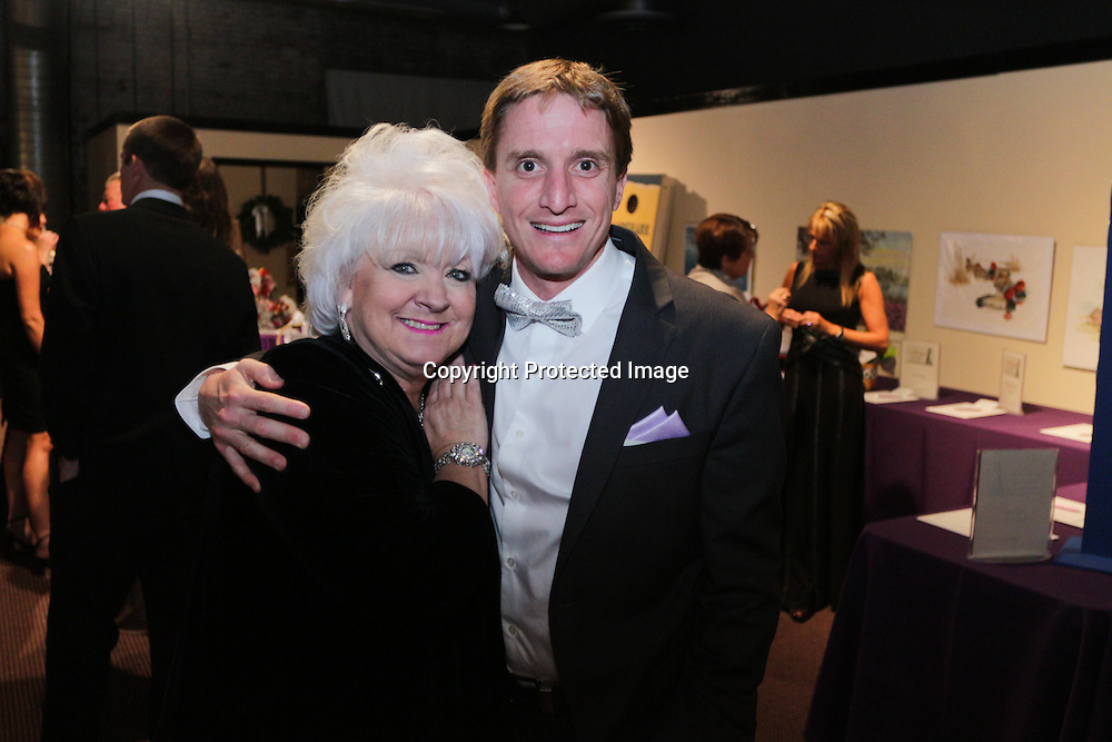 Elizabeth Barnes, left, and Colin Hackman pose for a picture during the Diamonds and Champagne Hope Ball Saturday November 22, 2014 at the Coastline Convention Center in Wilmington, N.C. (Jason A. Frizzelle)