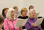 The women of the Dayton Philharmonic Chorus rehearse for their upcoming performance of Mahler's Third Symphony, Tuesday, January 2, 2007. (left to right - front row) Pat Armstrong, Vicki Siefke, Anne Crouch (middle row) Michele Foley, Barbara Singleton <br />(back row) Sharyn Veley, Willow Cliffswallow