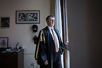 """PALERMO, ITALY - 7 JUNE 2016: Sergio Barbera, Deputy General Prosecutor of Palermo, poses for a portrait in his office in the courthouse of Palermo, Italy, on June 7th 2016.<br /> <br /> Between January 2014 e December 2015 more than 120 tons of hashish, carried on fishing boats or cargo ships from Morocco to Libya, were seized in the Strait of Sicily by Italy's Guardia di Finanza (Financial Police) thanks to an international police investigation named """"Operazione Libeccio"""", carried out by the GICO (Gruppo Investigativo Criminalità Organizzata, Organised Crime Investigation Group), a unit of the tax police of Palermo under the supervision of the DDA (Direzione Distrettuale Antimafia) of Palermo.<br /> <br /> """"What is happening in Libya is same historical occurrence that happened years ago in Afghanistan. Such as the Talibans who financed their terroristic activities with heroin trafficking for the purchase of weapons, the Caliphate is proposing the same terroristic strategy by purchasing and commercialising hashish in order to purchase weapons used in their war"""" Sergio Barbera, Deputy General Prosecutor of Palermo, said."""