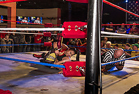 Karen Qu pins Deonna Purrazza during Pro Wrestling Injustice for Brawl at the Whiskey Barrel Saturday night.  (Karen Bobotas/for the Laconia Daily Sun)