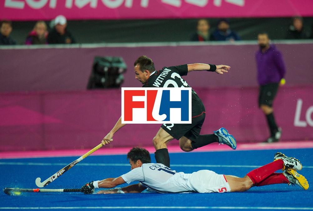LONDON - Olympische Spelen 2012.Men match .Korea v Germany.foto: Kang Moon Kweon tackle on Matthias Witthaus .FFU Press Agency COPYRIGHT FRANK UIJLENBROEK.