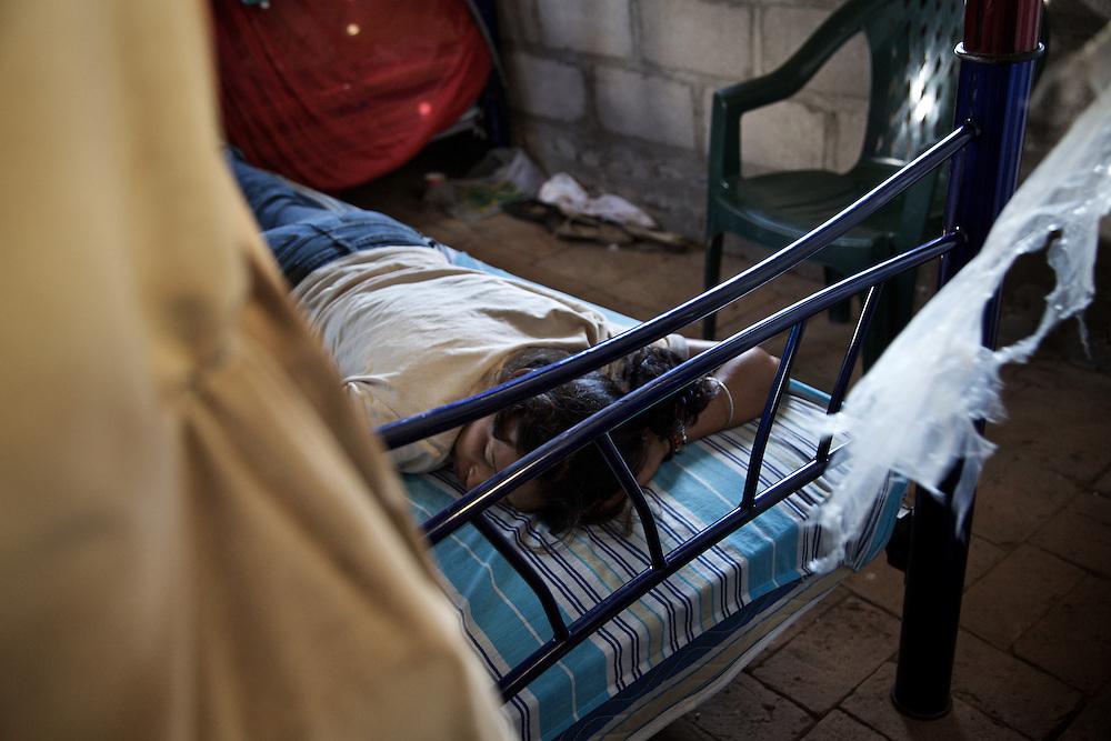 "young migrant exhausted by the long journey.Shelter ""Hermanos en el camino"" Ixtepec-Oxaca-Mexico,2011"