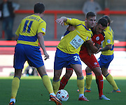 Accrington Stanley striker Billy Kee holds off a challenge from Crawley Town central defender Jon Ashton during the Sky Bet League 2 match between Crawley Town and Accrington Stanley at the Checkatrade.com Stadium, Crawley, England on 26 September 2015. Photo by Bennett Dean.