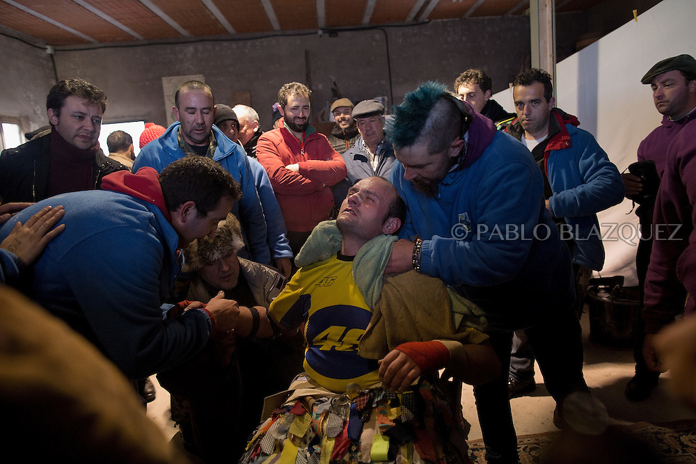 Stewards comfort Raul Beites after he finished his walk representing Jarramplas and beating his drum during the Jarramplas Festival on January 20, 2015 in Piornal, Spain. The centuries old Jarramplas festival takes place annually every January 19-20 on Saint Sebastian Day. Even though the exact origins of the festival are not known, various theories exist including the mythological punishment of Caco by Hercules, a relation to ceremonies celebrated by the American Indians that were seen by the first conquerors, to a cattle thief ridiculed and expelled by his village neighbours. It is generally believed to symbolize the expulsion of everything bad. This year the people who represented Jarramplas were Angel Cerro Fernandez on 19 January and Carlos Calle Rodríguez 47 and Raúl Beites Sánchez 34 on 20 January.