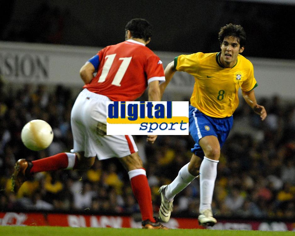 Photo: Ed Godden.<br /> Brazil v Wales. International Friendly. 05/09/2006.<br /> Ryan Giigs (L), is met by Brazil's Kaka.