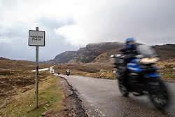 View of motorcycles on single track road on Bealach na Ba pass on Applecross Peninsula  the North Coast 500 driving route in northern Scotland, UK