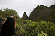 Maui. Tourist photographing the 'Iao Needle, Maui's most photographed landmark.