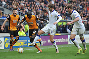 Hull City midfielder Mohammed Diame (17) under attack from Luke Murphy (8)  during the Sky Bet Championship match between Hull City and Leeds United at the KC Stadium, Kingston upon Hull, England on 23 April 2016. Photo by Ian Lyall.