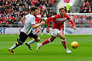Lloyd Kelly (17) of Bristol City battles for possession with Will Buckley (11) of Bolton Wanderers during the EFL Sky Bet Championship match between Bristol City and Bolton Wanderers at Ashton Gate, Bristol, England on 12 January 2019.