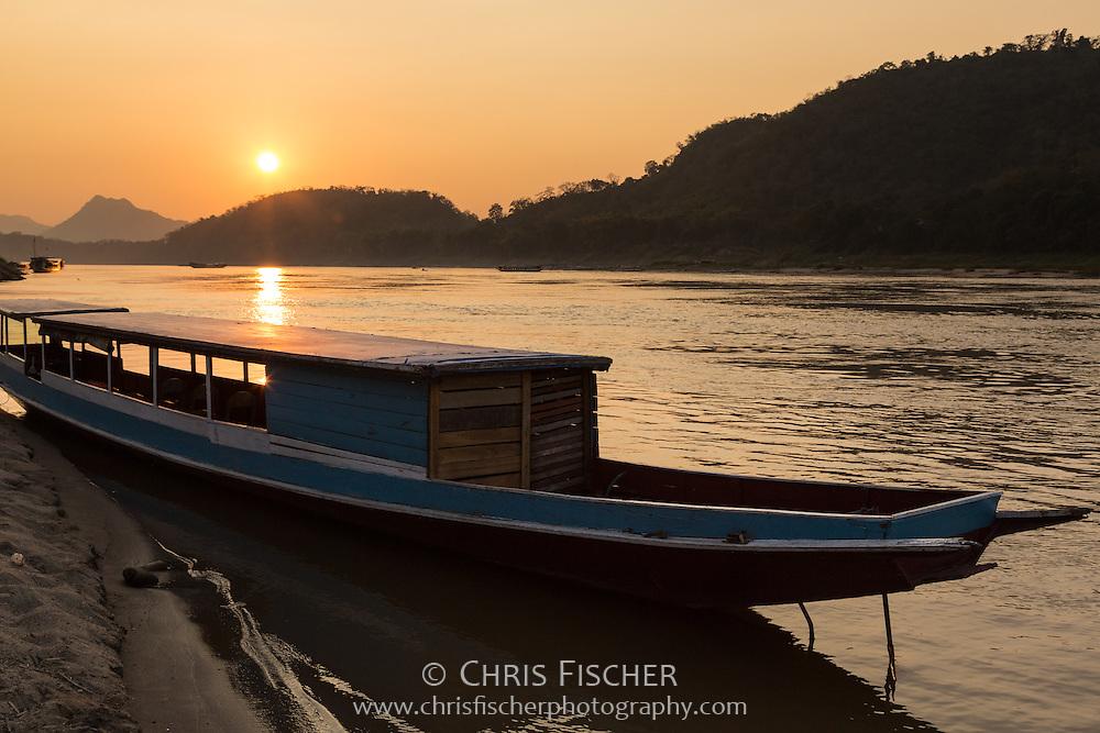 Boat on the Mekong River at sunset, Luang Prabang, Laos.
