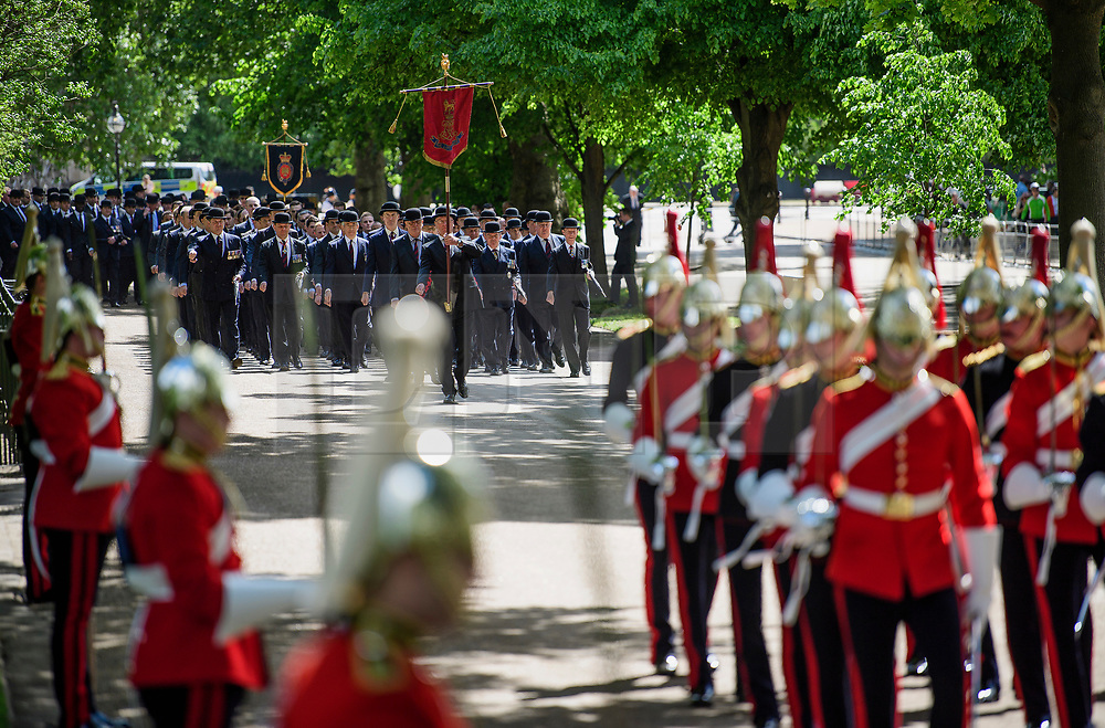 © London News Pictures. 14/05/2017. London, UK. Thousands of serving and former Cavalrymen, many wearing bowler hats and carrying closed umbrellas, take part in Combined Cavalry Old Comrades Association Annual Parade in Hyde Park, London. A service of remembrance is held to honour Cavalry and other troops who have fallen in the service of their country since the first world war. Photo credit: Ben Cawthra/LNP