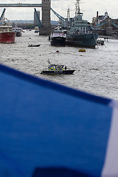 London Bridge, London, June 15th 2016. A flotilla of fishing boats led by UKIP's Nigel Farage heads through Tower Bridge in protest against the EU's Common Fisheries Policy and in support of Britain leaving the EU. PICTURED: Police try to keep order on the Thames as two opposing groups from Leave and Remain bustle about on the river Thames.