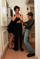 Beverly Hills-Actress Ashley Judd is fitted into her Valentino couture gown by make-up artist Ashlee Peterson as she prepares to host the Academy Awards sci-teck awards at the Regent Beverly Wilshire Hotel Saturday, February 28.<br />
