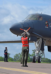 June 7, 2017 - Royal Air Force Fairford, United Kingdom - Air Force Airman 1st Class Jacob Feeback, a 28th Aircraft Maintenance Squadron crew chief, marshals a B-1B Lancer aircraft assigned to Ellsworth Air Force Base, S.D., at Royal Air Force Fairford, England, June 7, 2017. Bomber missions in the European theater enable crews to maintain a high state of readiness and proficiency, and validate the Air Force's always-ready global strike capability. Air Force photo by Tech. Sgt. Miguel Lara III (Credit Image: ? Tech. Sgt. Miguel Lara/DOD via ZUMA Wire/ZUMAPRESS.com)