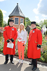 GABY ROSLIN and Chelsea Pensioners at the 2016 RHS Chelsea Flower Show, Royal Hospital Chelsea, London on 23rd May 2016