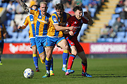 Ollie Rathbone is fouled  during the EFL Sky Bet League 1 match between Shrewsbury Town and Rochdale at Greenhous Meadow, Shrewsbury, England on 8 April 2017. Photo by Daniel Youngs.