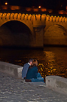 Paris, lovers sitting by the Seine at night - palette knife.