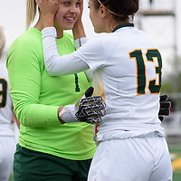 5th year midfielder Shayla Kapila (13) of the Regina Cougars shares a few words with 4th year goalkeeper Ashton Lowry (1) as she subs in during the Women's Soccer Homeopener on September 16 at U of R Field. Credit: Casey Marshall/Arthur Images