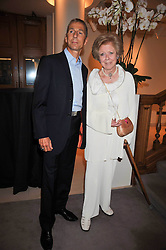 The 7th MARQUESS OF BUTE and LADY ANTHEA REES at fundraising dinner and auction in aid of Liver Good Life a charity for people with Hepatitis held at Christies, King Street, London on 16th September 2009.