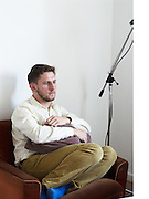 British Artist Steven Warwick aka Heatsick chillaxing in sofa chair at Bethanien Studios, Berlin