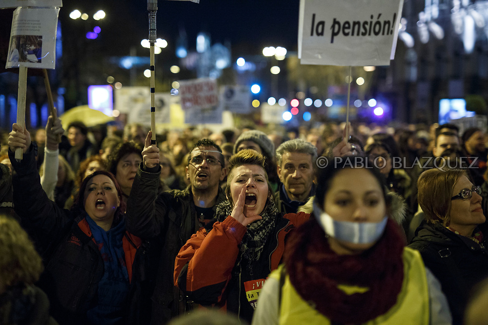 MADRID, SPAIN - MARCH 17:  Demonstrators march during a protest to claim decent pensions and against the 'citizens security law' also known as 'Gag Law' on March 17, 2018 in Madrid, Spain.  (Photo by Pablo Blazquez Dominguez)