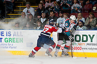 KELOWNA, CANADA - MARCH 23: Parker Wotherspoon #37 of the Tri-City Americans checks Ryan Olsen #27 of the Kelowna Rockets at the boards on March 23, 2014 at Prospera Place in Kelowna, British Columbia, Canada.   (Photo by Marissa Baecker/Shoot the Breeze)  *** Local Caption *** Parker Wotherspoon; Ryan Olsen;