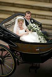 Peter Phillips and Canadian Autumn Kelly leave St. George's Chapel in Windsor after their marriage ceremony.<br /> Sang Tan/Anwar Hussein Collection/PA Photos