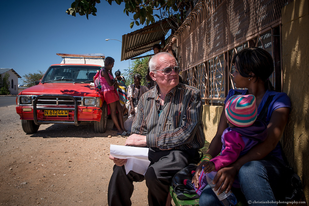 (2013) Father Hermann discusses an issue with one of the women in front of the Shelter in Katutura.