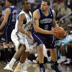 New Orleans Hornets guard Chris Paul #3 defends against Deron Williams #8 of the Utah Jazz in the second quarter of their NBA game on April 8, 2008 at the New Orleans Arena in New Orleans, Louisiana.