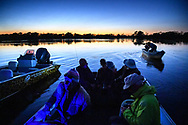 Tourists in a boat in the Pantanal, Mato Grosso, Brazil