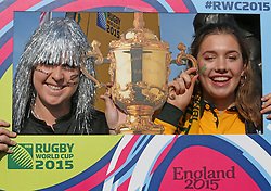 © Licensed to London News Pictures. 31/10/2015. London, UK. New Zealand and Australian rugby fans pose for a trophy photo as they arrive for the Rugby World Cup final at Twickenham. Photo credit: Peter Macdiarmid/LNP