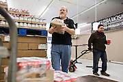 LITTLE ROCK, AR: DECEMBER 10, 2013<br /> Mark Riley volunteering under the direction of Cesar Ortega at the Mosaic Church in Little Rock, Arkansas helping to put out food.<br /> CREDIT: Wesley Hitt for The Wall Street Journal<br /> MENJOBS