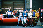 Punks and Skins by Trans Am car at Kings Cross, UK, 1980s.